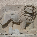 Delaminating lion horoscope relief
